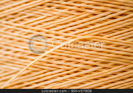 Close up of a Spool of Synthetic Orange Thread stock photo, Close up of a spool of synthetic orange thread by OZMedia