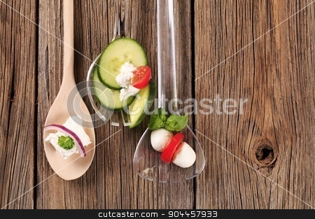 Fresh cheese and vegetables stock photo, Fresh cheese and vegetables on salad spoons by Digifoodstock