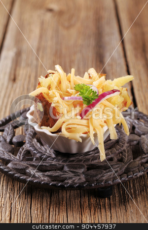 Baked potato and cheese stock photo, Baked potato sprinkled with grated cheese and onion by Digifoodstock