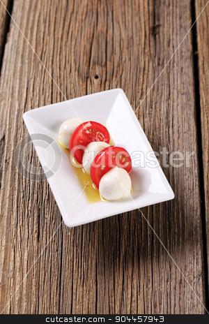Mozzarella cheese and tomato stock photo, Marinated mozzarella cheese balls and fresh tomato by Digifoodstock