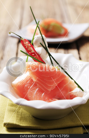 Appetizers stock photo, Slice of smoked salmon, mozzarella cheese and kiwi by Digifoodstock