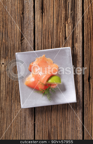 Smoked salmon stock photo, Thin slice of smoked salmon and wedge of  lime by Digifoodstock