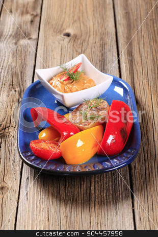 Vegetables and Romesco Sauce stock photo, Pan fried vegetables and a dish of vegetable puree by Digifoodstock
