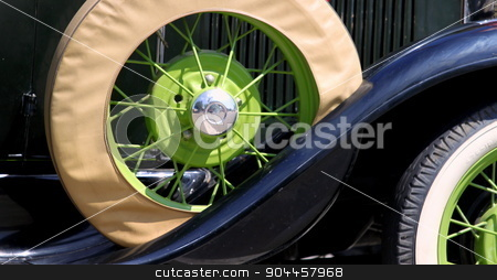 Old Car stock photo, Spare tire of an very old car. by Henrik Lehnerer
