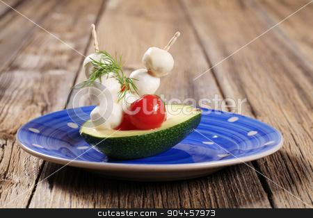 Vegetarian appetizer stock photo, Fresh avocado and mini Mozzarella balls on sticks by Digifoodstock