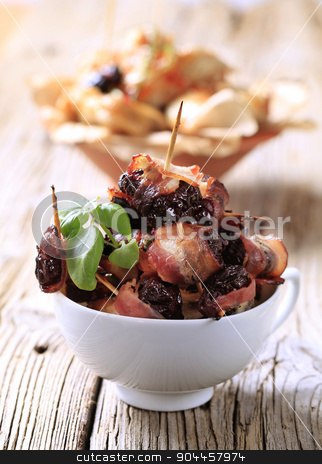 Bacon wrapped prunes stock photo, Prunes wrapped  in rashers of bacon - detail by Digifoodstock