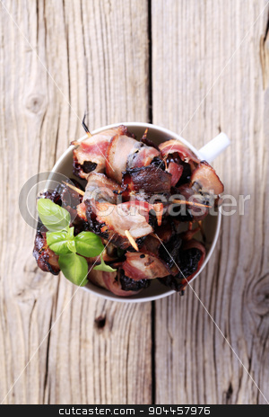 Bacon wrapped prunes stock photo, Bowl of delicious bacon-wrapped prunes - overhead by Digifoodstock