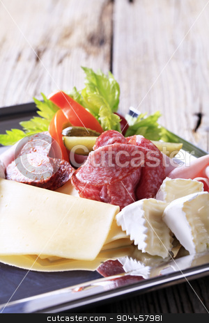 Cold cuts stock photo, Variety of cheeses and deli meats on a tray by Digifoodstock