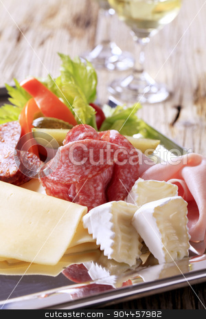 Cold cuts stock photo, Slices of assorted cheeses, ham, and salami by Digifoodstock