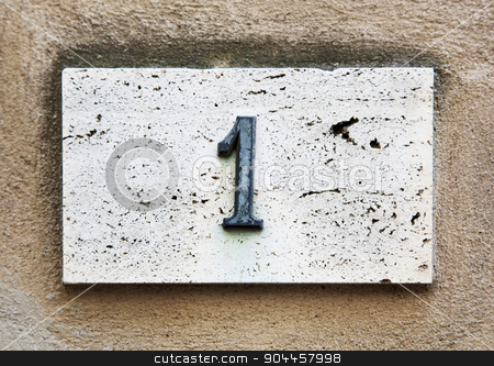 Block number on a wall  stock photo, Block number on a weathered wall - detail by Digifoodstock