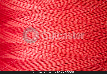Close up of a Spool of Synthetic Pink Thread stock photo, Close up of a spool of synthetic pink thread by OZMedia