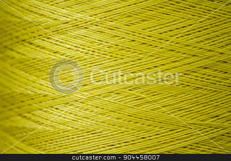 Close up of a Spool of Synthetic Green Thread stock photo, Close up of a spool of synthetic green thread by OZMedia