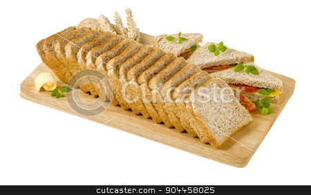 Whole wheat bread and sandwiches stock photo, Whole wheat bread and sandwiches on cutting board by Digifoodstock