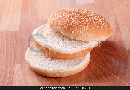 Sesame seed bun  stock photo, Slices of sesame seed bun - ready for hamburger by Digifoodstock