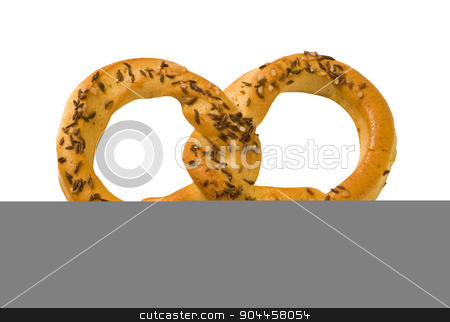 Pretzel stock photo, Pretzel topped with caraway and salt by Digifoodstock
