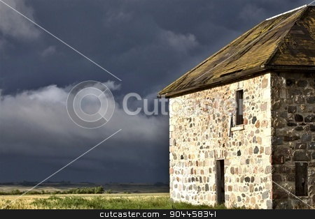 Storm Clouds Prairie Sky Stone House stock photo, Storm Clouds Prairie Sky Canada Ominous danger by Mark Duffy