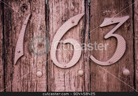 Weathered Wooden Fencing With The Number 163 stock photo, Weathered wood painted pink with the number 163. by Matthew Langenheim