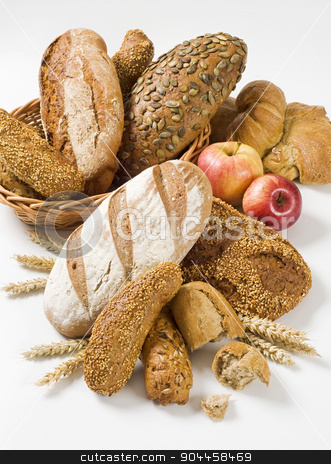 Variety of brown bread stock photo, Various types of bread and rolls - studio by Digifoodstock