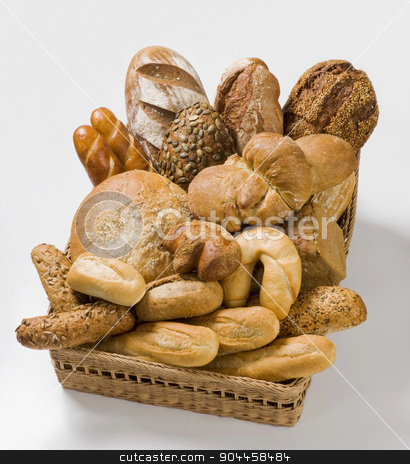 Variety of bread stock photo, Variety of baked products in a basket by Digifoodstock