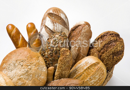 Various types of bread stock photo, Various types of bread in a basket by Digifoodstock