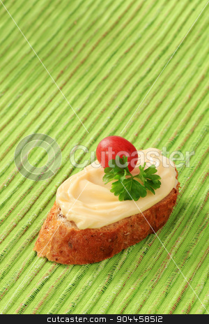 Bread and cheese spread stock photo, Slice of bread roll and creamy cheese spread by Digifoodstock