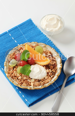 Whole grain breakfast cereal stock photo, Breakfast cereal, fresh fruit and sweet cream cheese by Digifoodstock