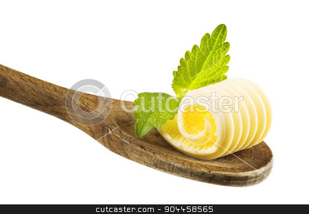Butter curl on a wooden spoon stock photo, Butter curl on a wooden spoon by Digifoodstock