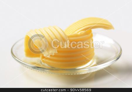 Butter curls  stock photo, Butter curls on glass plate by Digifoodstock