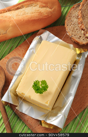 Block of fresh butter  stock photo, Block of fresh butter and bread - closeup by Digifoodstock
