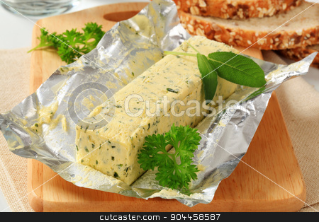 Herb butter  stock photo, Stick of fresh herb butter and bread by Digifoodstock