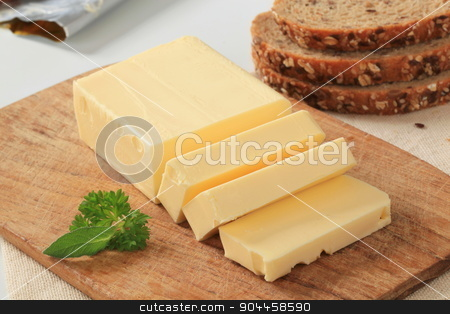 Block of fresh butter  stock photo, Block of fresh butter and brown bread by Digifoodstock