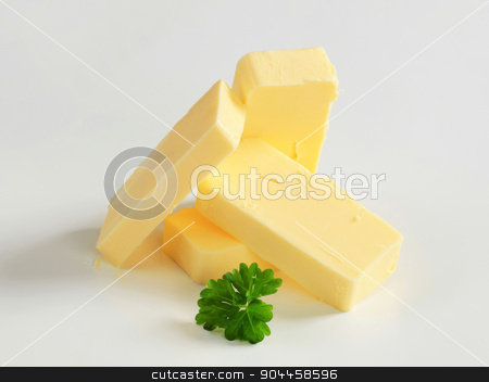 Fresh butter  stock photo, Pieces of fresh butter  - studio shot by Digifoodstock