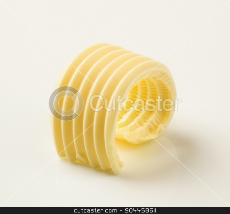 Butter curl  stock photo, Studio shot of a curl of fresh butter by Digifoodstock