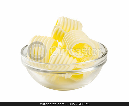 Butter curls in a glass bowl stock photo, Butter curls in a glass bowl isolated on white  by Digifoodstock