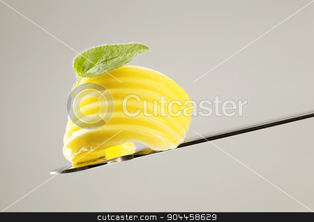Butter curl on a knife  stock photo, Curl of fresh butter on a knife  by Digifoodstock