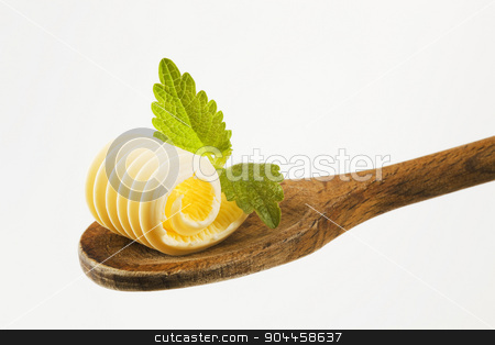 Butter curl on a wooden spoon  stock photo, Closeup of butter curl on a wooden spoon   by Digifoodstock