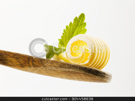 Butter curl on a wooden spoon  stock photo, Closeup of a butter curl on a wooden spoon   by Digifoodstock