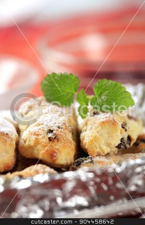 Mini Christmas stollen  stock photo, Mini Christmas stollen cakes in aluminum foil by Digifoodstock