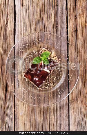 Vanilla cream cake stock photo, Slice of vanilla cream cake with chocolate icing by Digifoodstock