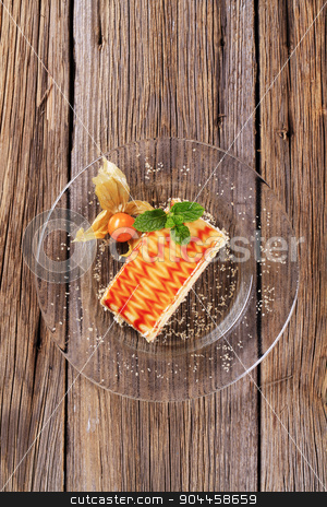 Dessert stock photo, Slice of delicious cake topped with syrup by Digifoodstock