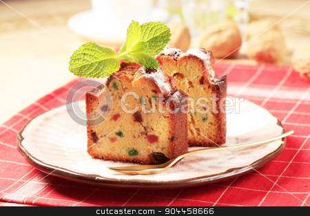 Slices of fruitcake stock photo, Two pieces of fruit cake on plate by Digifoodstock