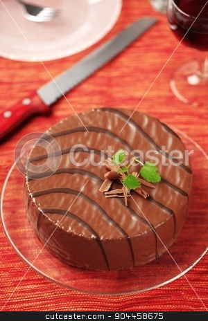 Chocolate glazed cake stock photo, Delicious nut cake glazed with chocolate icing   by Digifoodstock