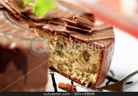 Chocolate-glazed cake stock photo, Delicious nut cake glazed with chocolate icing   by Digifoodstock