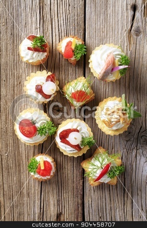 Canapes stock photo, Variety of pastry-based canapes with various toppings by Digifoodstock