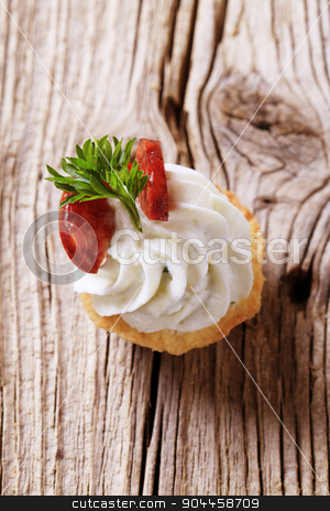 Canape stock photo, Canape - Pastry base with savory spread topping and salami by Digifoodstock