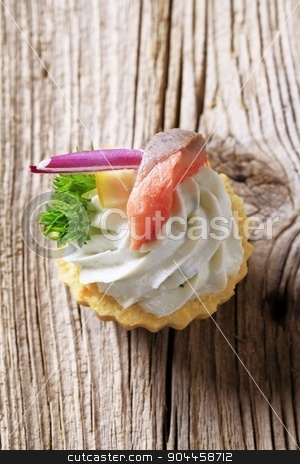 Canape stock photo, Tart pastry with spread and fish topping  by Digifoodstock