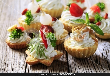 Variety of canapes stock photo, Variety of pastry-based canapes with various toppings by Digifoodstock