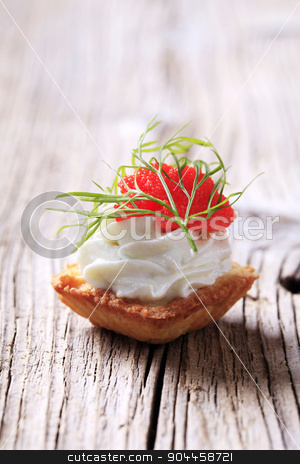 Canape stock photo, Pastry-based canape with savory spread and caviar by Digifoodstock