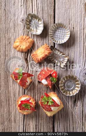 Appetizers and small tartlet tins stock photo, Pastry based canapes and small tartlet tins by Digifoodstock