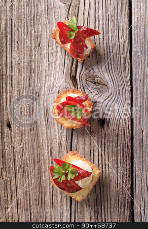 Tartlet canapes stock photo, Tartlet based canapes with pieces of spicy salami by Digifoodstock
